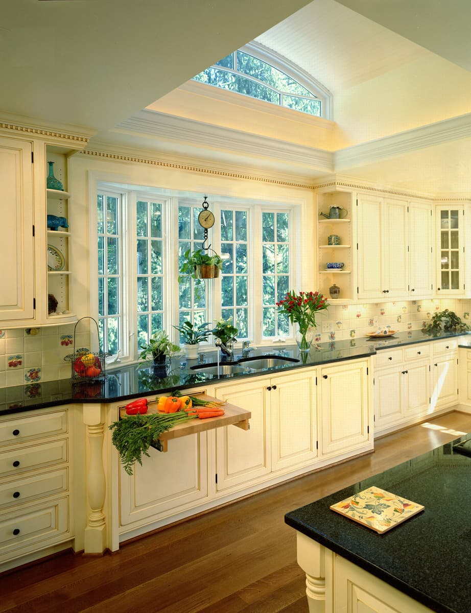 A timeless white kitchen in the French Country Style