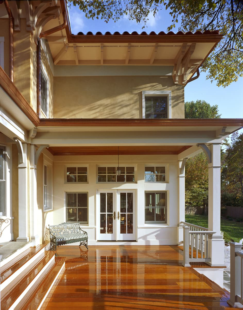 An inviting rear porch in the Italianate Villa Style